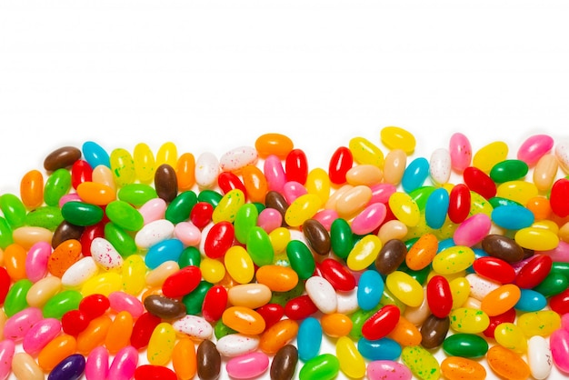 Colorful jelly beans white background. top view.
