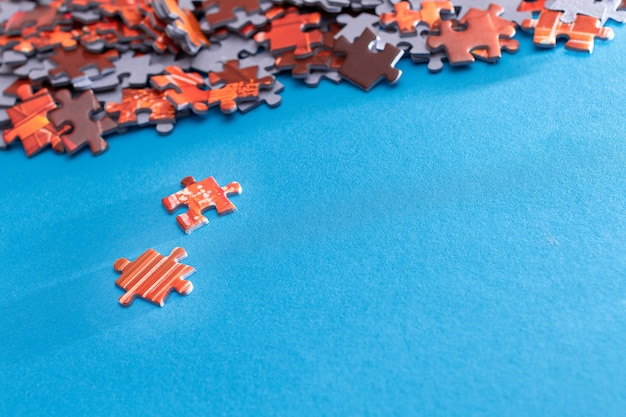 Colorful jigsaw puzzle on blue background
