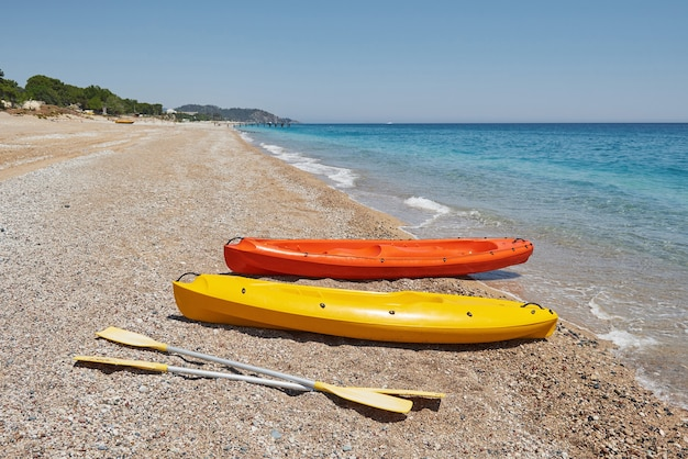 Colorful kayaks on the beach. beautiful landscape.
