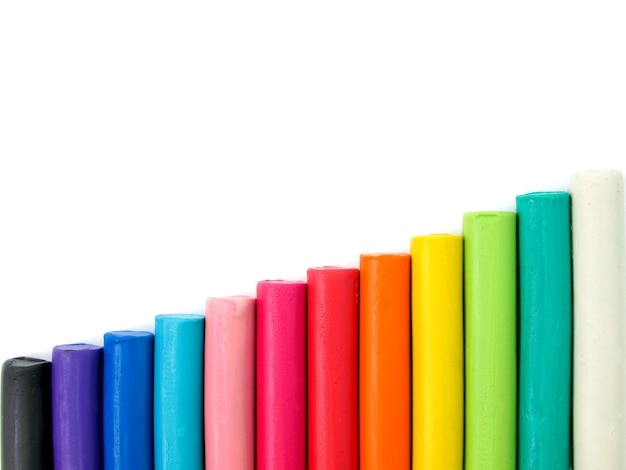 Разноцветный детский пластилин на белом