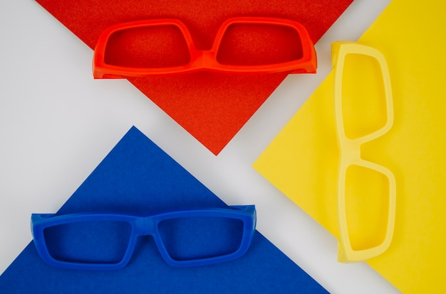 Colorful kids eyeglasses on background