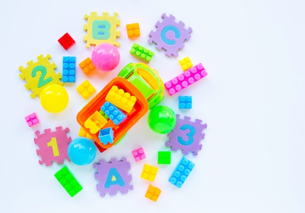 Colorful kids toys on white