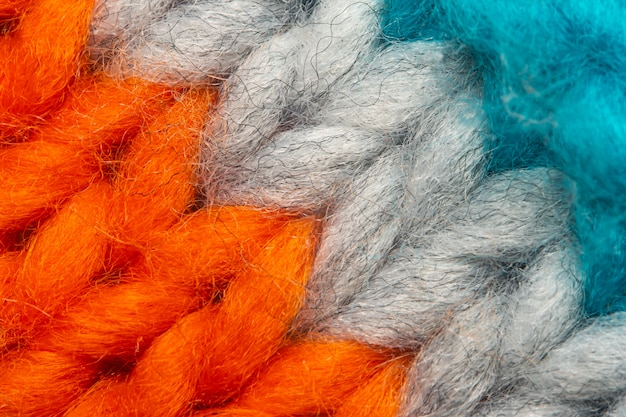 Colorful knit sweater texture macro. empty copy space background with saturated sweater.