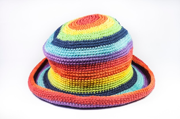 Colorful knitting wool hats on white background