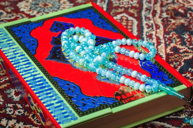 Colorful koran with rosary. holy book for muslims for ramadan concept