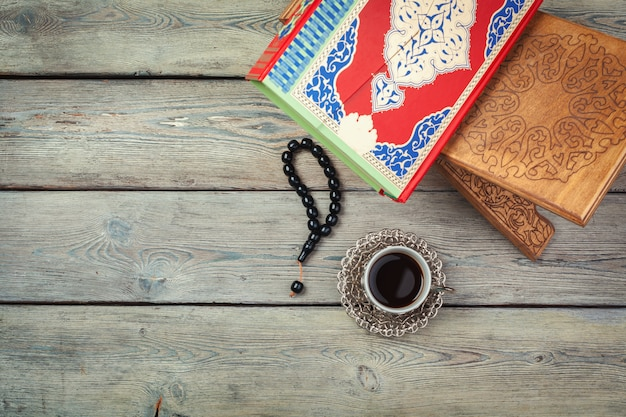 Colorful koran with rosary  on the wooden background. holy book for muslims for ramadan concept