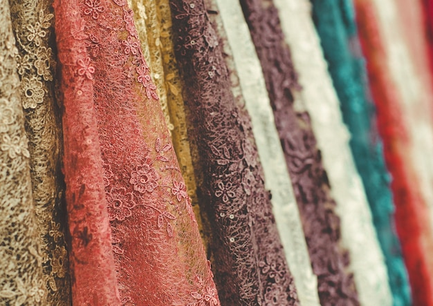 Colorful  lace fabric  rolls in textile shop industry