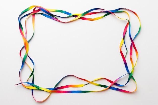 Colorful laces frame on white background