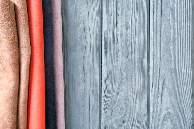 Colorful leather on wooden background