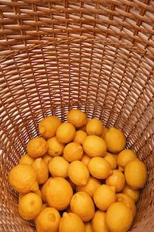 Colorful lemons fruit whole wicker lemonade lemon tree yellow citrus vitamin c semicircle vertical
