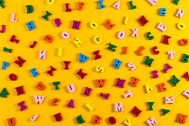 Colorful letters of the english alphabet on a yellow background.