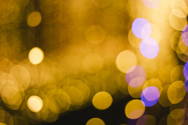 Colorful light abstract circular bokeh of christmas and happy new year background. Premium Photo