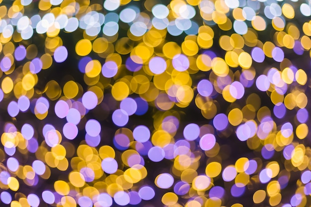 Colorful light abstract circular bokeh of christmas and happy new year background.