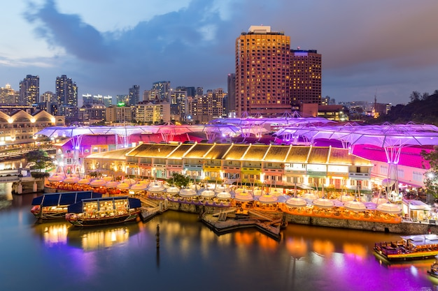 Colorful light building at night in clarke quay, singapore.