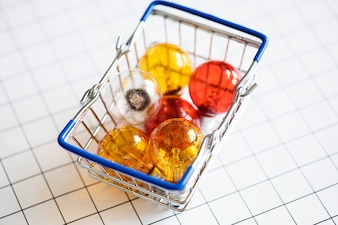 Colorful light bulbs in a basket