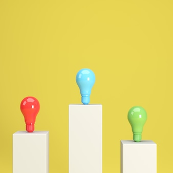 Colorful light bulbs standing on podiums
