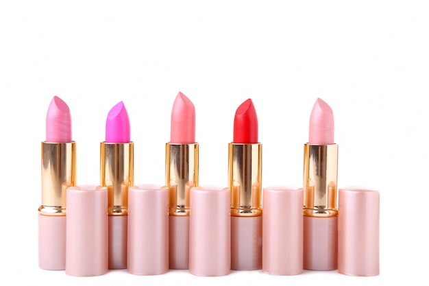 Colorful lipsticks isolated on white background