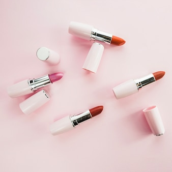 Colorful lipsticks in white tubes