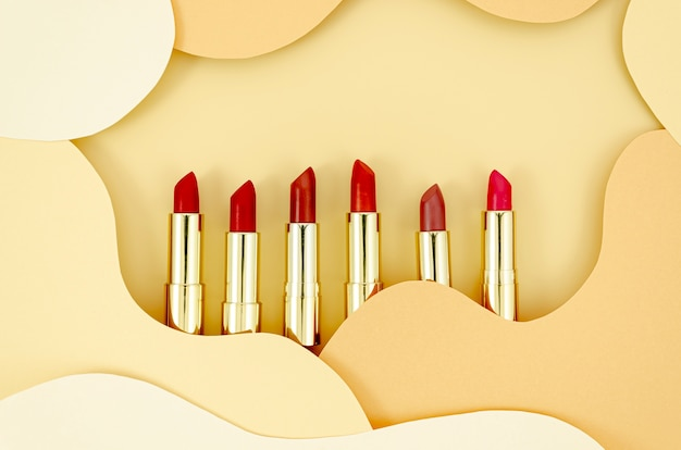 Colorful lipsticks with abstract background