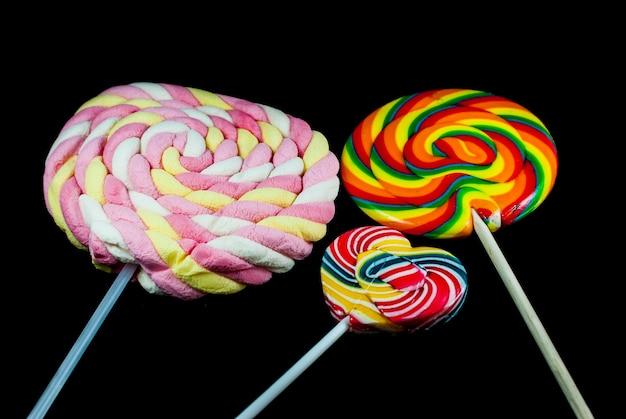 Colorful lollipop on black background