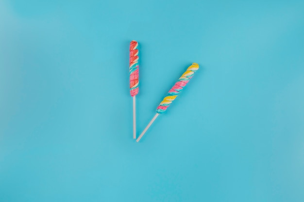 Colorful lollipop on blue background
