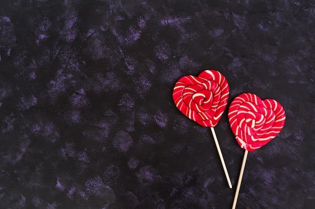 Colorful lollipops on dark