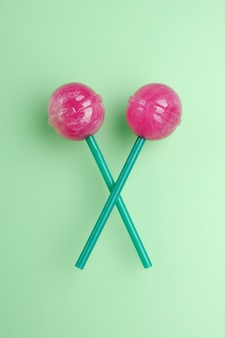 Colorful lollipops isolated. candy concept on mint green background with copy space