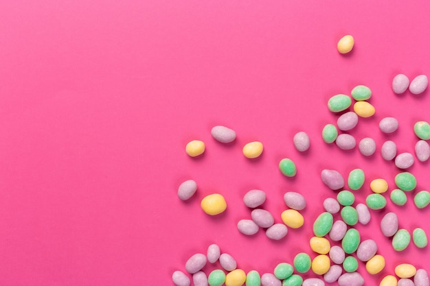 Colorful lollipops on a pink