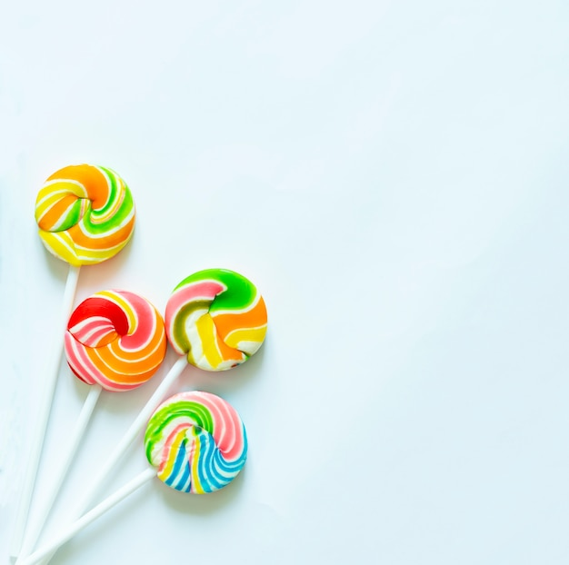 Colorful lollipops on white background