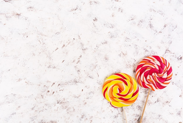Colorful lollipops on white