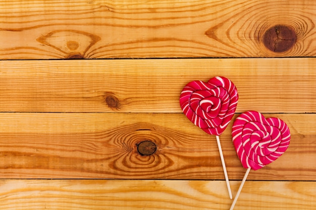 Colorful lollipops on wooden. top view
