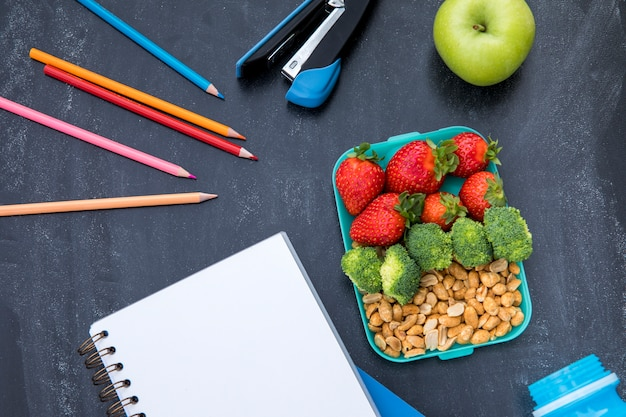 Colorful lunch with stationery on table
