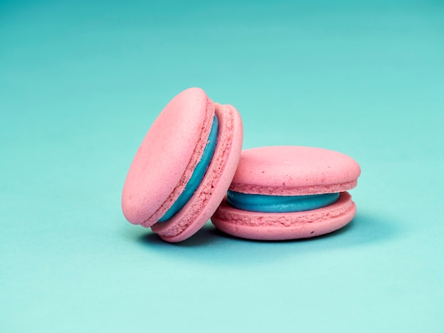 Colorful macarons on a blue background