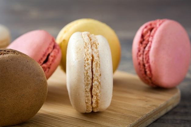 Colorful macarons on wooden table
