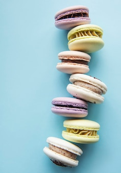 Colorful macaroons  arranged over blue surface