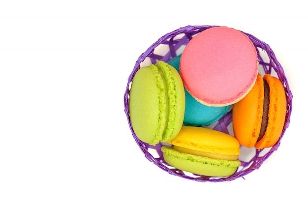 Colorful macaroons in a bamboo basket