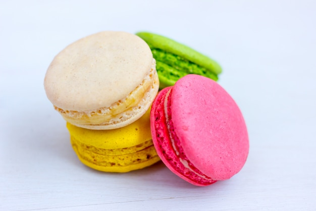Colorful macaroons on light background.