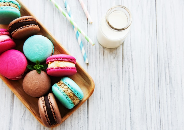 Colorful macaroons and milk