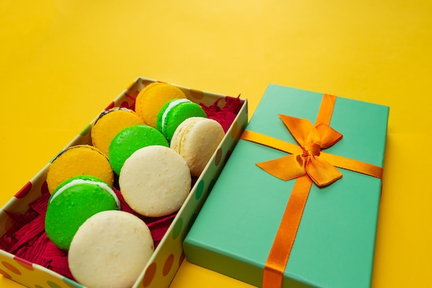 Colorful macaroons. sweet macaroons on color background with copy space. holiday time concept