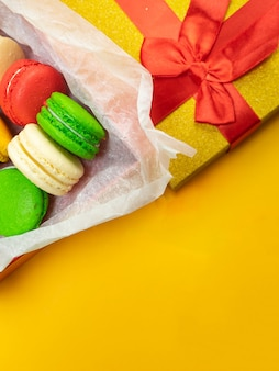 Colorful macaroons. sweet macaroons on color background with copy space. top view, holiday time concept