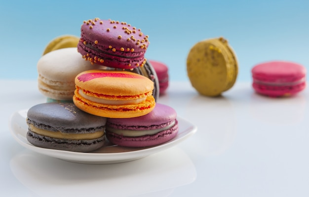 Colorful macaroons. sweet macaroons on light blue  holiday time
