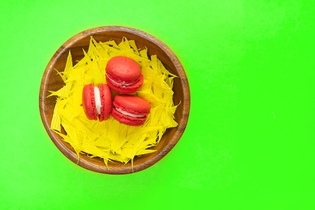 Colorful macaroons . sweet macaroons in wooden dish. copy space.