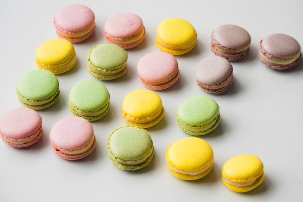 Colorful macaroons on white backdrop