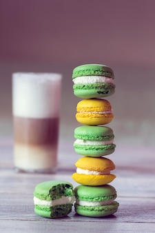 Colorful macaroons with latte