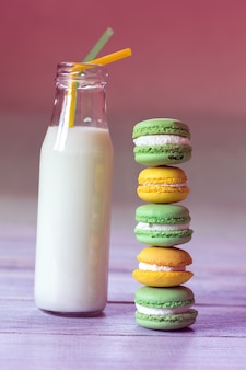 Colorful macaroons with milk