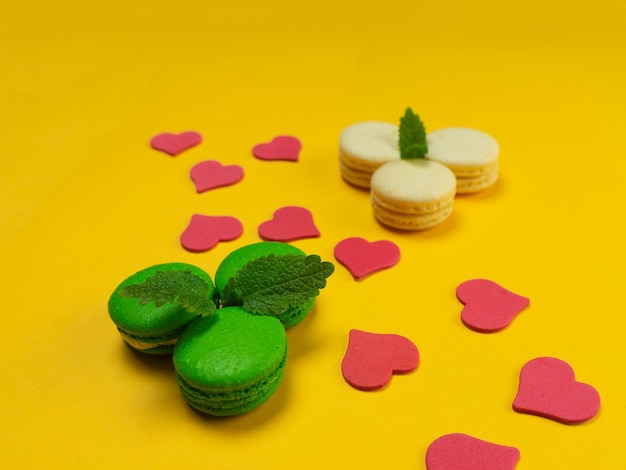 Colorful macaroons on a yellow background. concept for the holiday. copy space