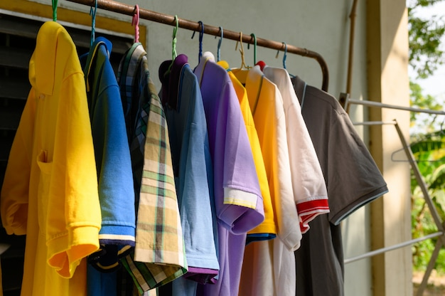 Colorful male shirt hanging on clothes line in sunny