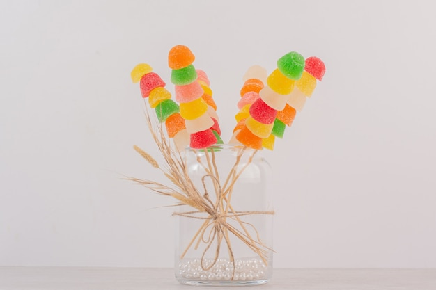 Colorful marmalades sticks in glass jar.