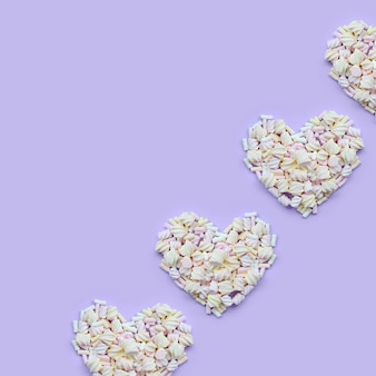 Colorful marshmallow heart shape. pastel creative textured hearts. minimal