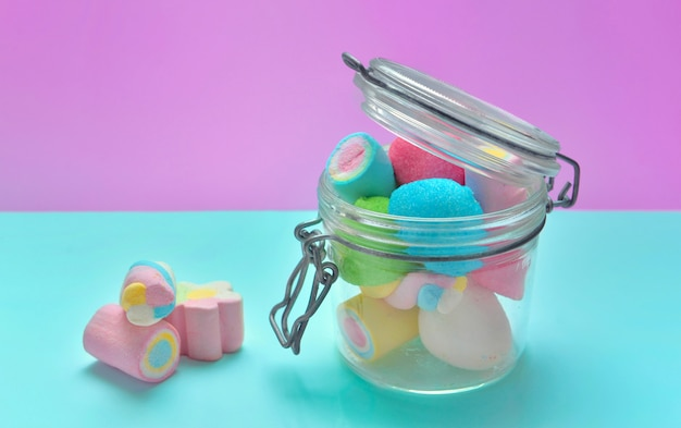 Colorful marshmallows in a glass jar